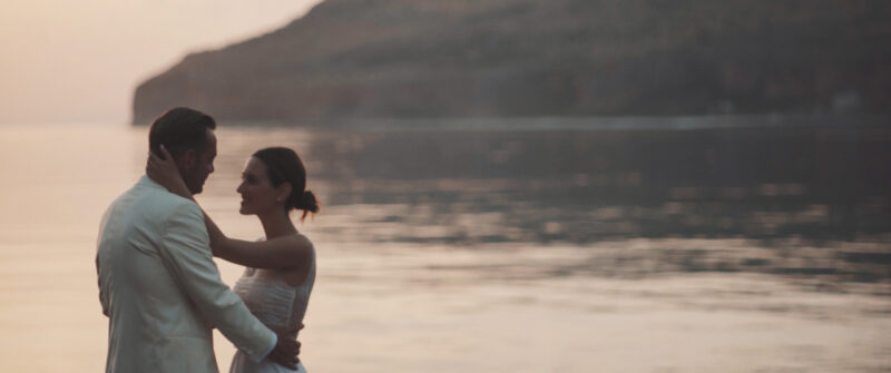 Shot taken during magic hour. Kiss with amazing sunset at Limeni, Greece. An elegant wedding at Mani with I wish chic events | whitefilming